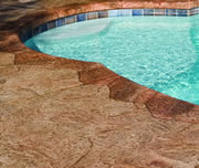pool concrete resurfaced with stamped stone pattern